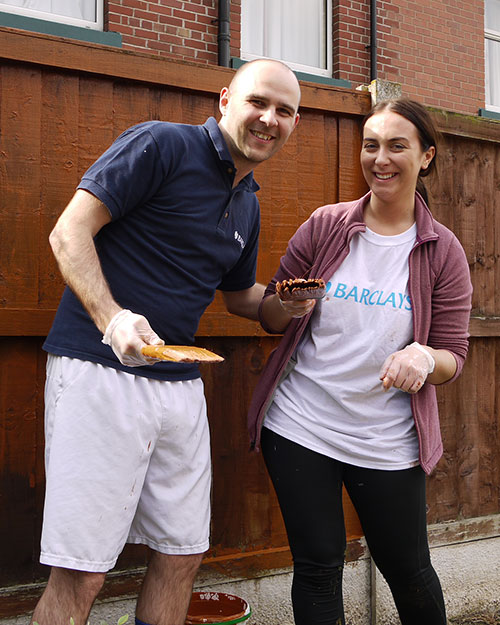 Staff from Barclays in Wavertree, Liverpool help Woodlands Hospice by painting their fences